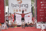 Age groupers arrive at the finish at the 2015 Beijing…
