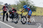 Andreas Raelert (DEU) changes his rear wheel after a puncture…