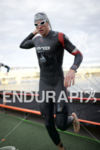 The pro men exit the water at Ironman Arizona on…