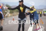 Aid station volunteers on the bike course at Ironman Arizona…