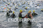Challenged athlete gets into water and starts the swim at…