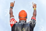 Athlete praying before the swim portion of the 2016 Ironman…
