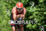 TJ Tollakson during the bike portion of the 2016 Ironman…