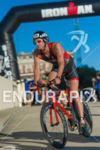 Biker leaving transition at the 2016 Ironman Wisconsin in Madison,…