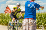 Cyclist at aid station at the 2016 Ironman Wisconsin in…