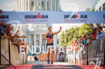 Female pro athlete Liz Lyles  approaching the finish line in…