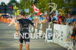 Canadian age group athlete shows his pride with flag while…