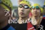 Age groupers line up for the swim start at the…