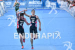 Aistair Brownlee pushes Jonathan Brownlee during the finish portion of…