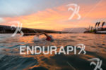 athlete swims to the swim start at the 2016 Ironman…