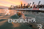 Timothy Van Berkel (AUS) swims to the swim start at…