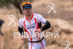 Ben Collins (USA) extends lead on the run during the…