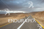 Athletes bike on the lonley, empty abnd challenging course at…