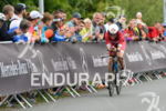 Bianca Steurer (AUT) competes during the bike leg at the…
