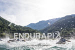 Athletes swim in the clear waters of the Vaujany's lake…