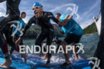 Athletes exit the clear water of the Vaujany lake at…
