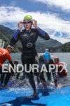 Athletes exist the clear water of the Vaujany Lake at…