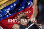 An athlete reaches the finish at the 2017 Ironman Santa…