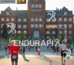 Runners pass the historic Science Building on the UW campus…