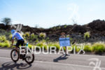 James Cunnama (ZAF) passes a female spectator holding a sign…
