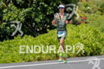 Josh Amberger (AUS) competes during the run leg at the…