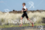 David Mcnamee (GBR) competes during the run leg thru the…