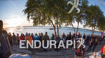 Spectators line the swim venue shore at the 2018 Ironman…