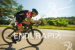 Age group athlete enjoying a are downhill on the bike…