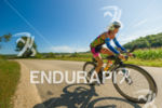 Female athlete  enjoying a gorgeous day on the bike course…