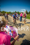 Age group competitor enjoying the crowd support on one of…