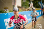 Age group athlete starting the run with a smile at…