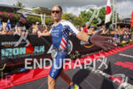 Andrew Starkowicz (USA) slaps hands running down the finish chute…