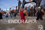 Patrick Lange enters the water to begin to the swim…