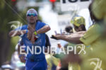 Patrick Lange passes an aid station during the run leg…