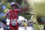 Daniela Ryf passes an aid station during the run leg…