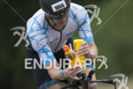 A participant reloads at an aid station along the bike…
