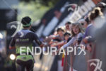 Supporters high-five finishers at the 2019 Ironman Santa Rosa triathlon…