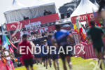 Age groupers reach the finish line of the 2019 Escape…