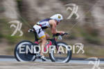 Jesse Vondracek on bike at the  Ironman 70.3 California on…