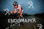 Nicholas Thompson on bike at the  Ironman 70.3 California on…