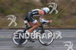 Matt Reed on bike at the  Ironman 70.3 California on…
